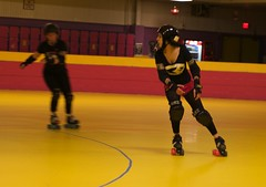 winter sport(0.0), speed skating(0.0), ice skating(0.0), skating(1.0), roller sport(1.0), sports(1.0), roller derby(1.0), roller skating(1.0),