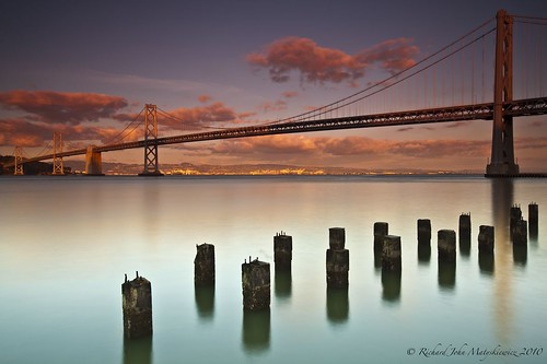 sanfrancisco california bridge sunset sky seascape water clouds america reflections landscape oakland coast unitedstates shore richard baybridge bayarea coastline pilings westcoast wonderfullight richardmatyskiewicz matyskiewicz treasureinland