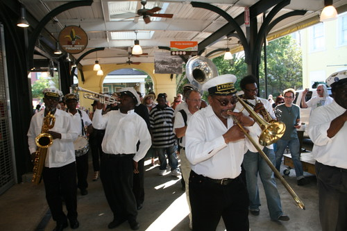 The Treme Brass Band leads a second line for Fats Domino in the French Market (Photo by Jef Jaisun)
