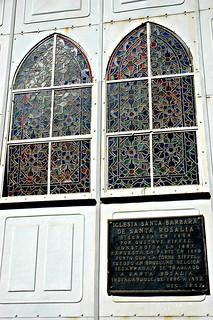 Stained glass windows and dedication - Inglesia Santa Barbara de Santa Rosalia, Metal church designed by Gustave Eiffel, enscription, San Rosalia, Baja California Sur, Mexico