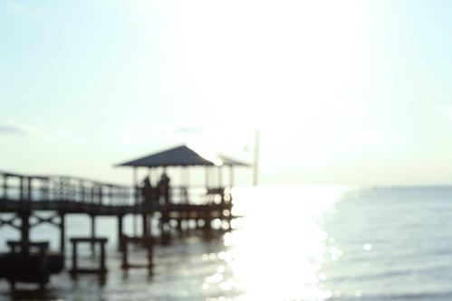 sun blur beach water mobile bay pier fairhope