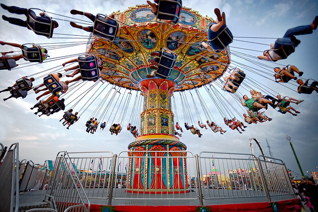 physics of carousel The swing ride or chair swing ride (sometimes called a swing carousel, wave swinger, yo-yo, chair-o-planes or swinger) is a fairground ride that is a variation on the carousel in which the chairs are suspended from the rotating top of the carousel.