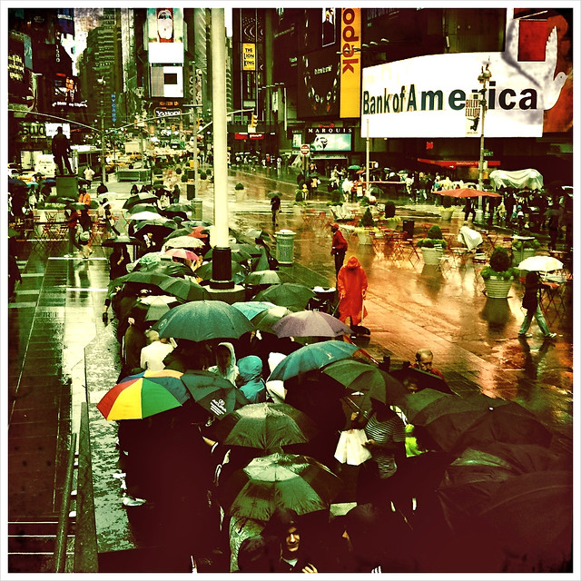 """Raindrops Keep Falling on Times Square's Umbrellas"""