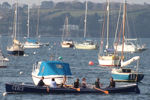 Circe, Cornish Racing Gig arriving back at Mylor Harbour, Carrick Roads (River Fal) by Stocker Images