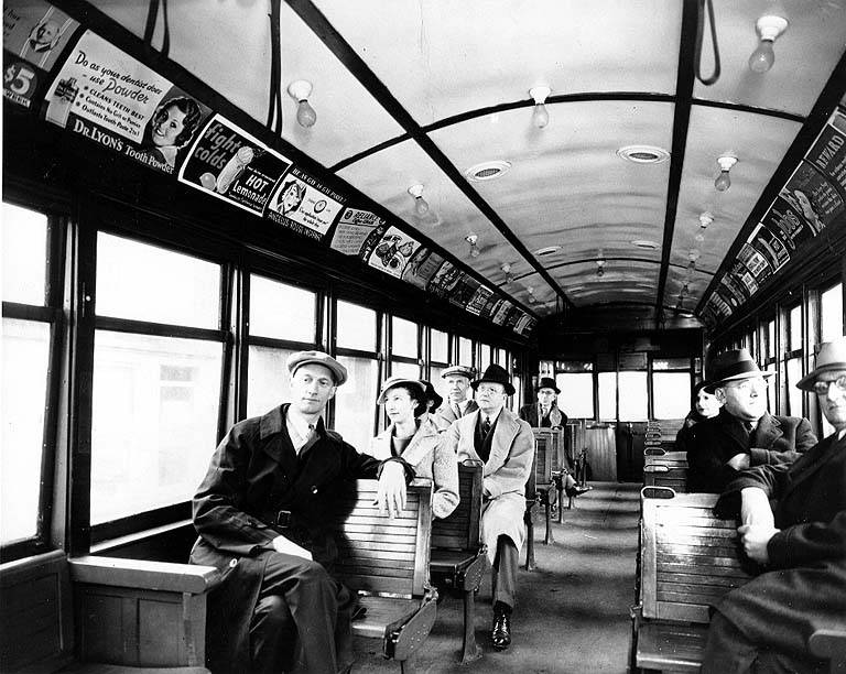 Interior of streetcar with passengers, Seattle