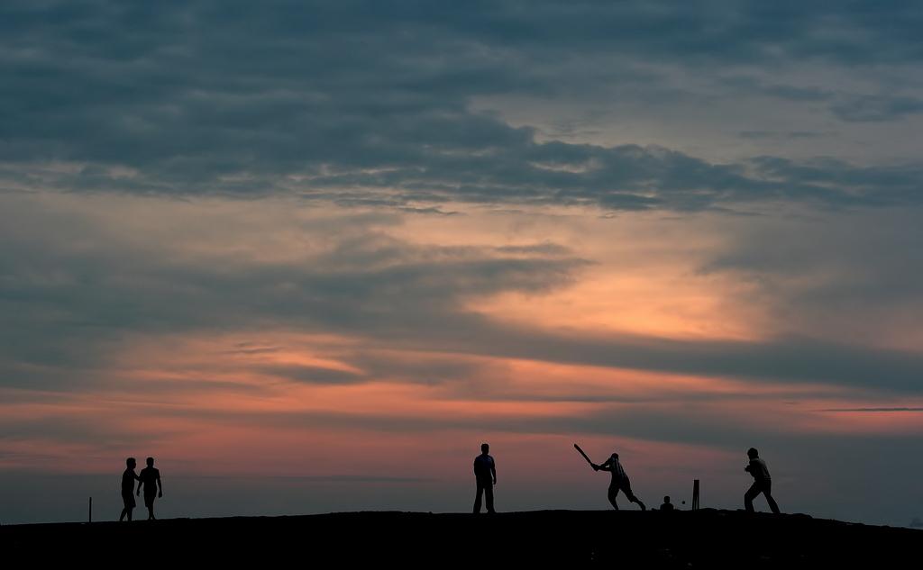 Early morning beach cricket