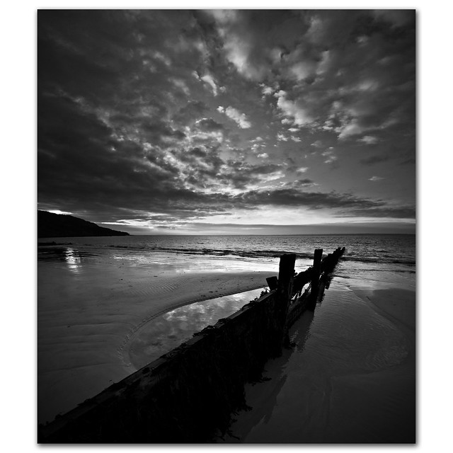 A puddle full of sky. Black & white reflections from Totland