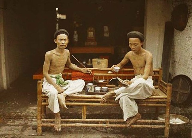 Tonkin - Hanoi: Two opium smokers drinking tea, 1915