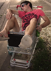 Person drinking in a shopping cart
