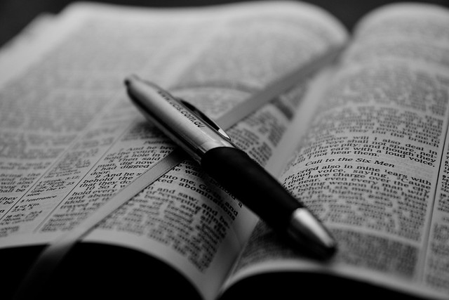 Open Bible with pen - B&W from Flickr via Wylio