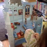 Dani playing cars in a princess castle