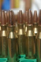 firearm(0.0), metal(1.0), close-up(1.0), ammunition(1.0),