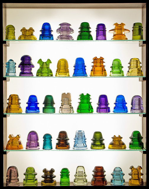 Rainbow colors of glass insulators flickr photo sharing for Power line insulators glass