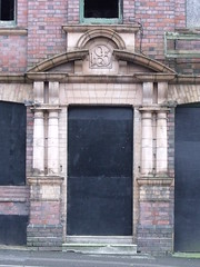 The derelict buildings at 63 - 64 Ludgate Hill, Birmingham - 1903 and boarded up door