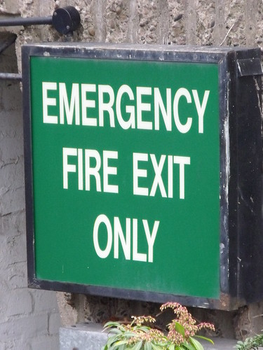 Crowne Plaza - Hotel from Suffolk Street Queensway - signs - Emergency Fire Exit Only