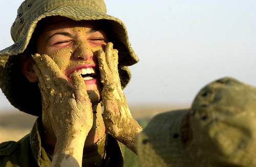 Female Combat Soldiers Applying Camouflage