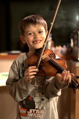 nick, practicing violin after dinner