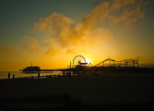 ocean california santa sunset people water wheel clouds pier sand pacific flag silhouettes ferris monica roller coaster