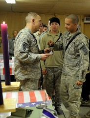 soldier-takes-communion-at-christmas-service