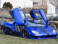 race car, automobile, automotive exterior, ssc aero, wheel, vehicle, automotive design, land vehicle, supercar, sports car,