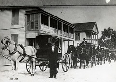 amish(1.0), vehicle(1.0), snow(1.0), coachman(1.0), history(1.0), monochrome photography(1.0), horse and buggy(1.0), land vehicle(1.0), monochrome(1.0), carriage(1.0), black-and-white(1.0),
