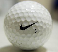 white(1.0), golf ball(1.0), macro photography(1.0), golf equipment(1.0), close-up(1.0), ball(1.0),