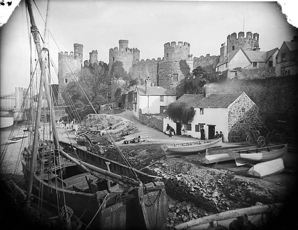 Boats and ships on the river bank with the castle in the background, Conwy