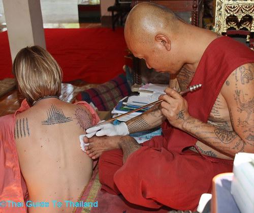 Thai milf with tattoo