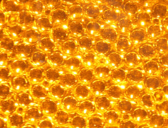 christmas decoration(0.0), font(0.0), christmas lights(0.0), gold(0.0), art(1.0), orange(1.0), pattern(1.0), yellow(1.0), amber(1.0), design(1.0), circle(1.0), bling-bling(1.0), gold(1.0), lighting(1.0),