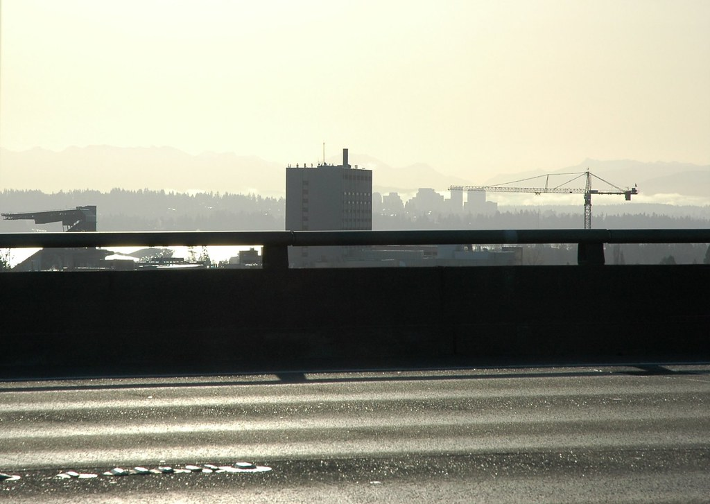 Seattle and Bellevue, Cascade mountains in the distance from the deck of Highway 5 bridge, U District, Seattle, Washington, USA