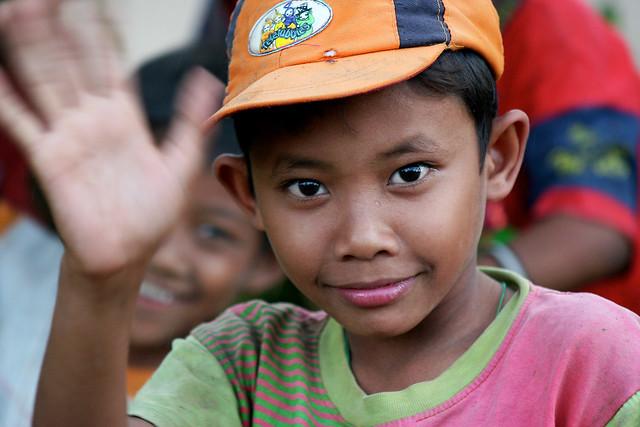 Waving boy in the Manila slums, Phillipines.