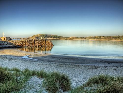 sunset beach water grass geotagged alderney channelislands braye douglasquay fortalberts geo:lat=49722796 geo:lon=2199706