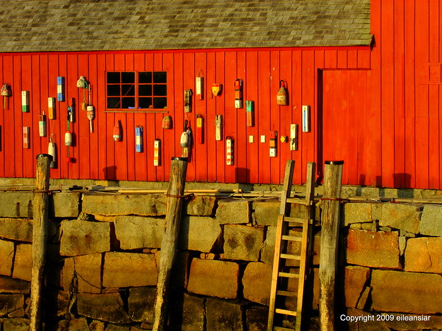Red lobster shack on stone jetty in Rockport