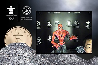 Spider-Man sending greetings at the Royal Canadian Mint's picture booth (during the Vancouver 2010 Olympics)
