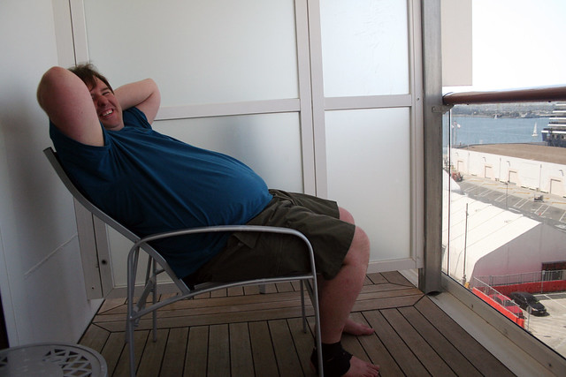 Carnival spirit mike reclining on extended balcony for Cruise balcony vs suite