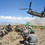 Vermont Guardsmen and Afghan troops wait on a CH-47 Chinook helicopter to land after completing an air assault mission