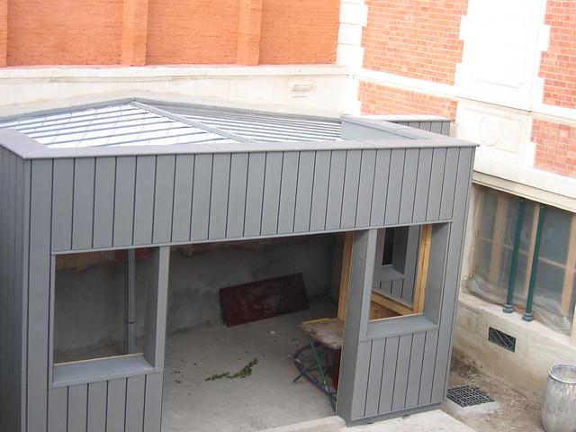 Extension ossature bois bardage zinc renovation bardage zinc isolation naturelle protection for Bardage fundermax ossature bois