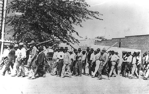 African-Americans being marched through Tulsa, Oklahoma when white racists killed over 300 people and destroyed numerous homes, churches and businesses in a rampage supported by the authorities. by Pan-African News Wire File Photos