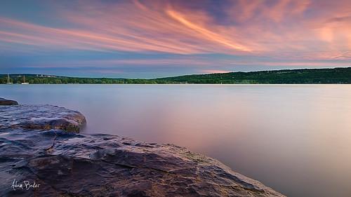longexposure sunset summer orange lake ny water yellow clouds canon landscape rocks warm purple vivid upstate panoramic ithaca portfolio cayuga tompkins cpl 1740l eastshorepark gnd adambaker 5dmarkii