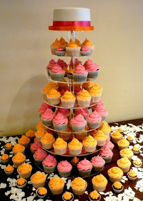 Pink and orange wedding cupcake tower This is a lovely wedding cupcake