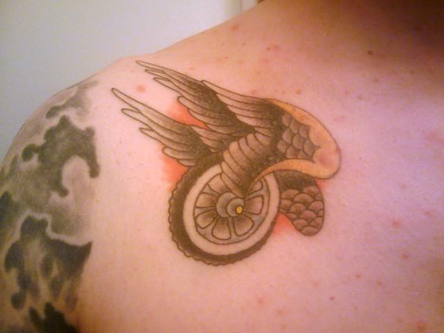 Flying Wheel Tattoo