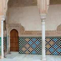 baluster(0.0), mural(0.0), curtain(0.0), iron(0.0), modern art(0.0), floor(1.0), art(1.0), arch(1.0), wall(1.0), interior design(1.0), design(1.0), tile(1.0), wallpaper(1.0), flooring(1.0),