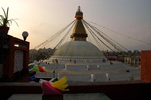 Boudha Stupa from the east, restaurant rooftop, napkins, umbrella, Boudha, Kathmandu, Nepal by Wonderlane