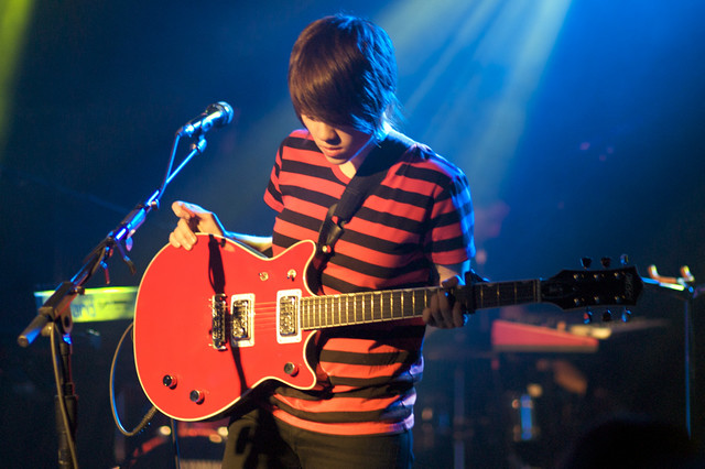 Sara Quin of Tegan and Sara (red guitar)