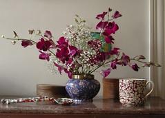 art(0.0), purple(0.0), pink(0.0), flower arranging(1.0), cut flowers(1.0), flower(1.0), branch(1.0), artificial flower(1.0), floral design(1.0), plant(1.0), lilac(1.0), centrepiece(1.0), flower bouquet(1.0), floristry(1.0), still life(1.0), ikebana(1.0),