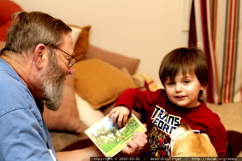 showing chips & jed his finished jigsaw puzzle