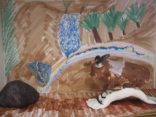 Buddy Bison walking on a bridge under a rainbow -  a diorama created by Bullis Third Grader