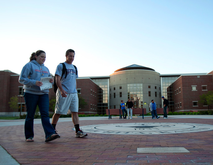 Newman students walking in front of Gorges Atrium
