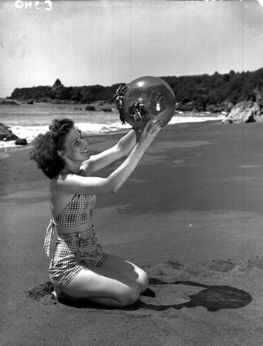 Girl holding Japanese glass net float with mussels on top of it