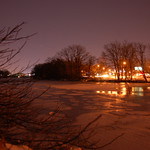 Charles River, 21 December 2009: Night shot of road traffic & patches of ice on the frozen river